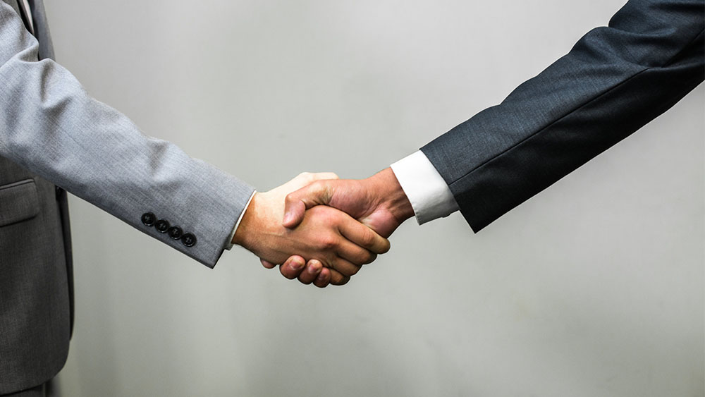 common denominator in business handshake